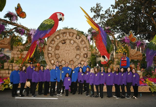 People whose lives have been affected by organ, eye and tissue donation line up in front of the 2018 Donate Life Rose Bowl Parade float