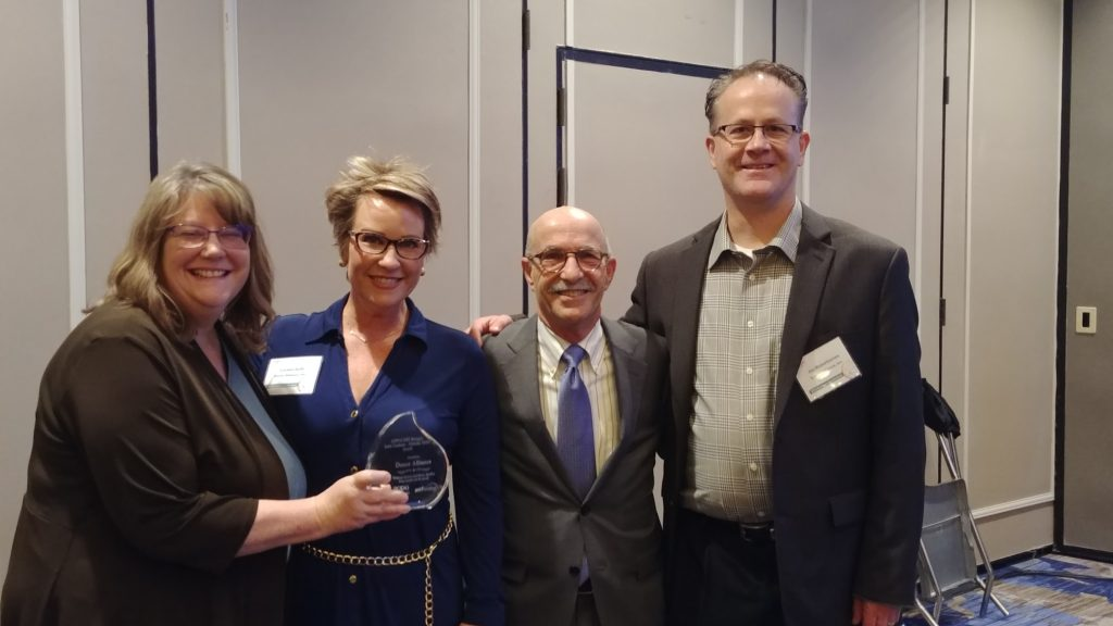 Donor Alliance representatives pose with AOPO award